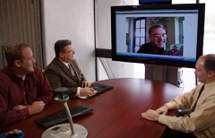 Team members collaborate and keep a personal touch via videoconferencing with remote clients.